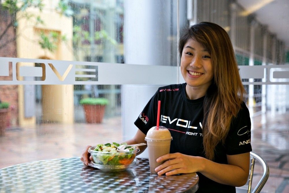 ONE Women's Atomweight World Champion Angela Lee eats a salad and drinks a smoothie at Evolve MMA