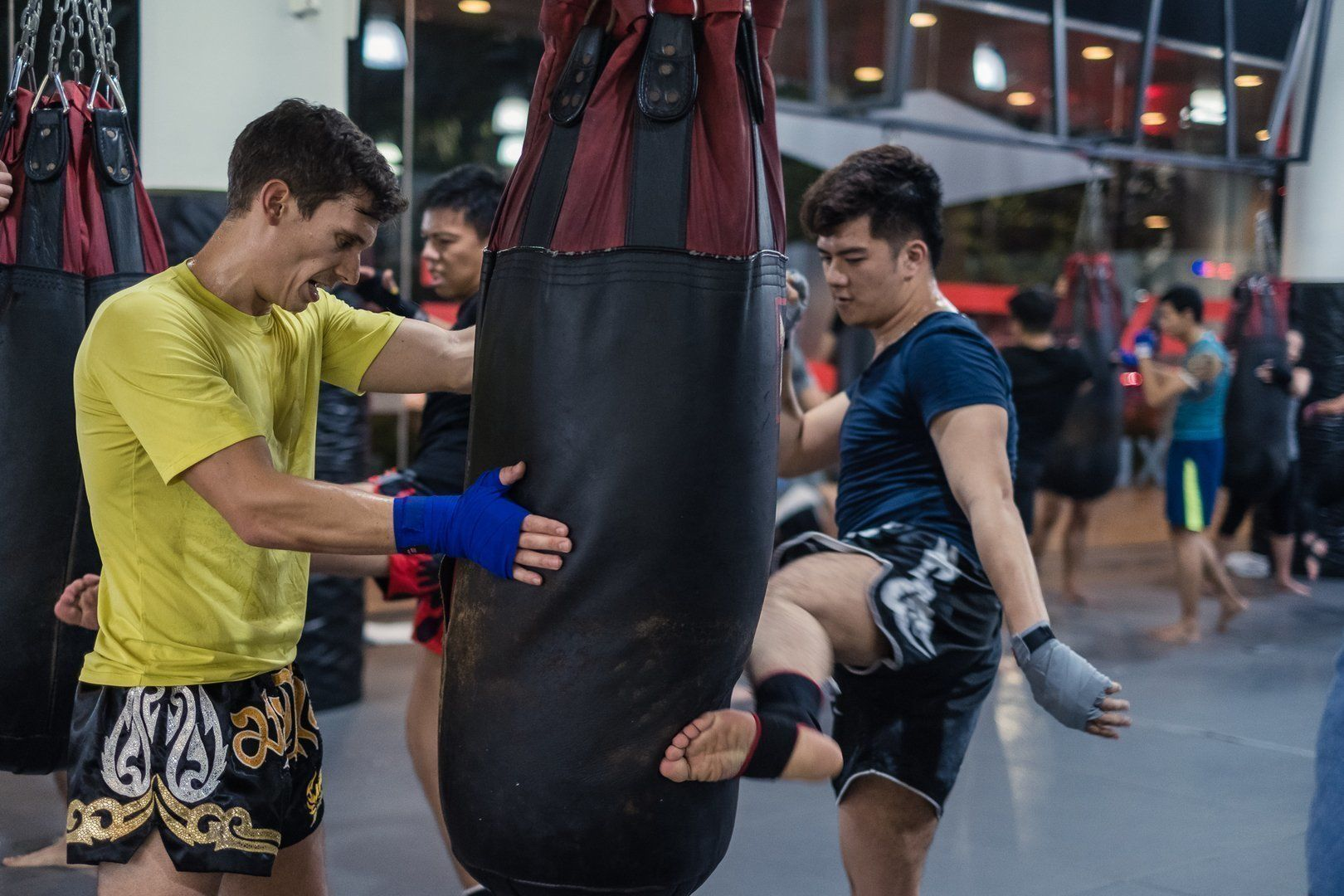 Two friends train Muay Thai at Evolve