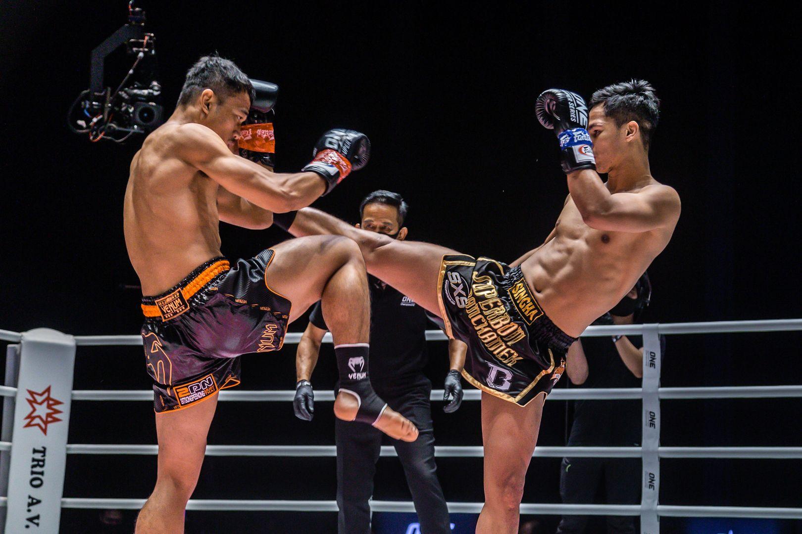 Thai star Superbon throws a kick at his rival, Sitthichai