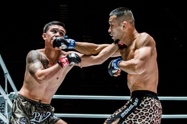 Japanese fighter Akihiro Fujisawa punches Pongsiri Mitsatit