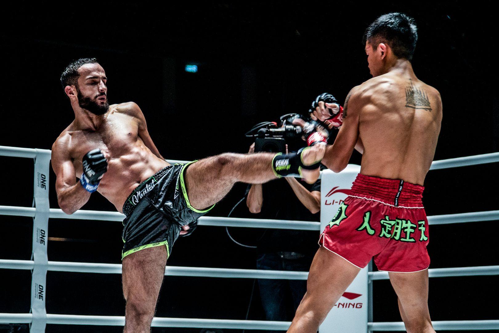 Tunisia's Fahdi Khaled throws a kick at Huang Ding