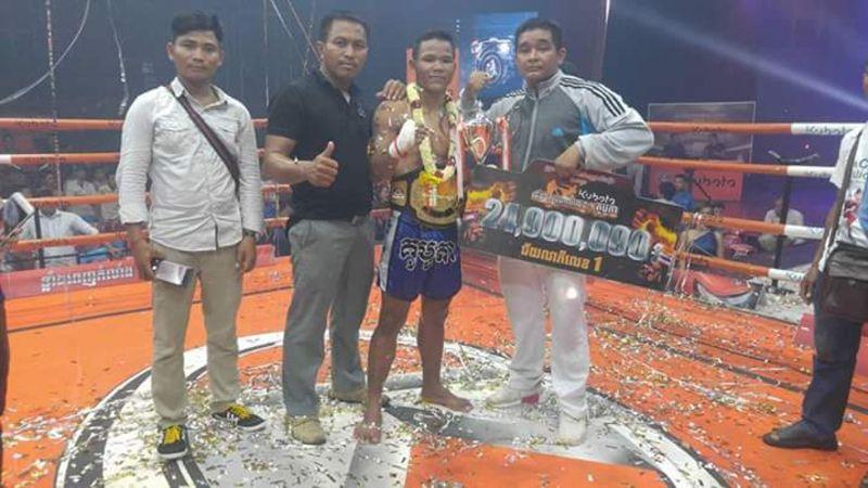 Cambodian striker Sok Thy with his Kun Khmer World Championship
