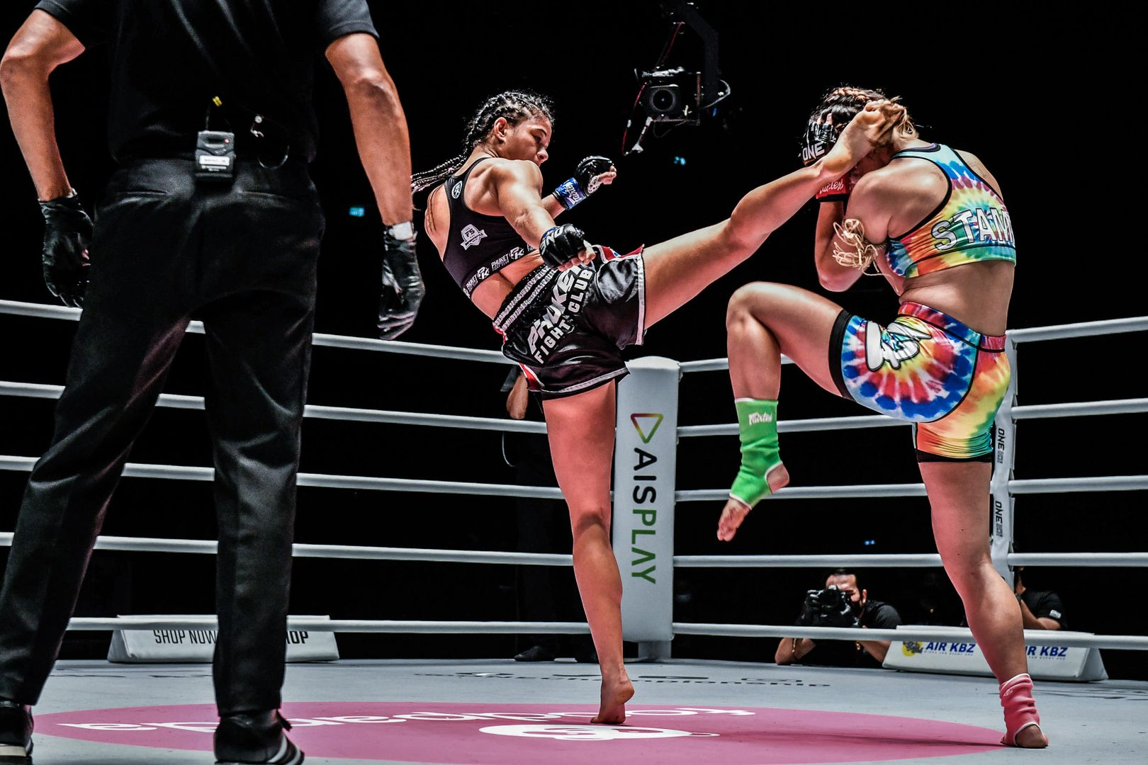 Brazilian Muay Thai fighter Allycia Hellen Rodrigues throws a head kick at Stamp Fairtex