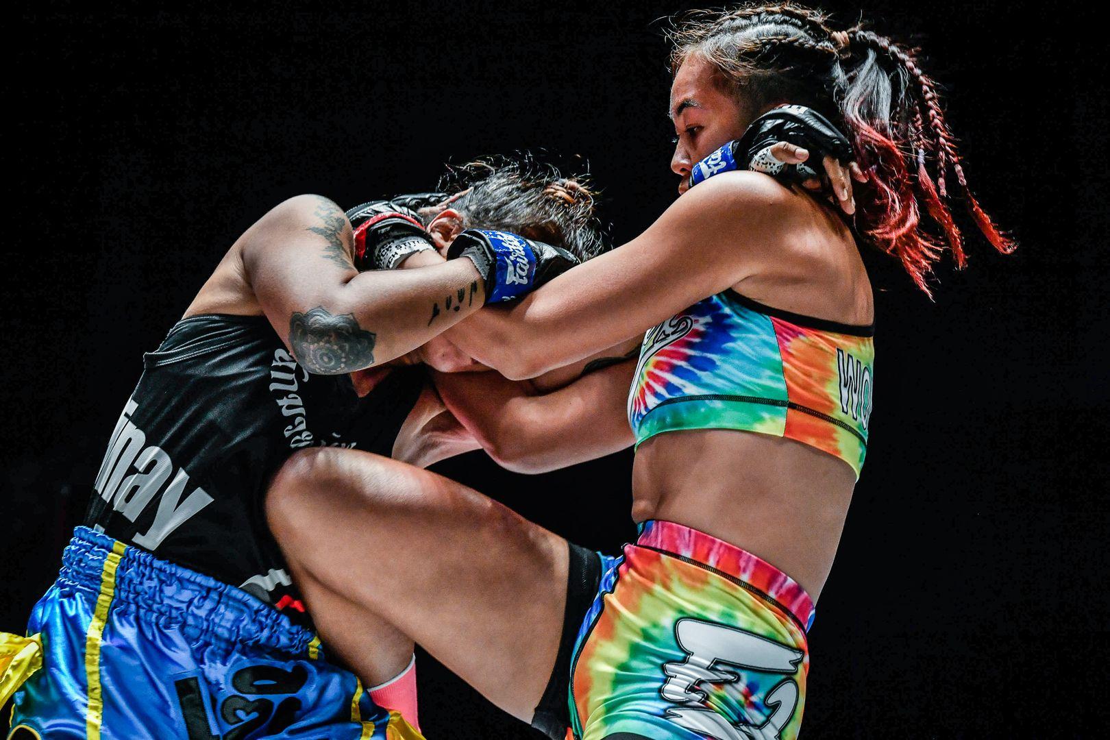 Muay Thai fighter Wondergirl Fairtex throws her knee into KC Carlos' ribs