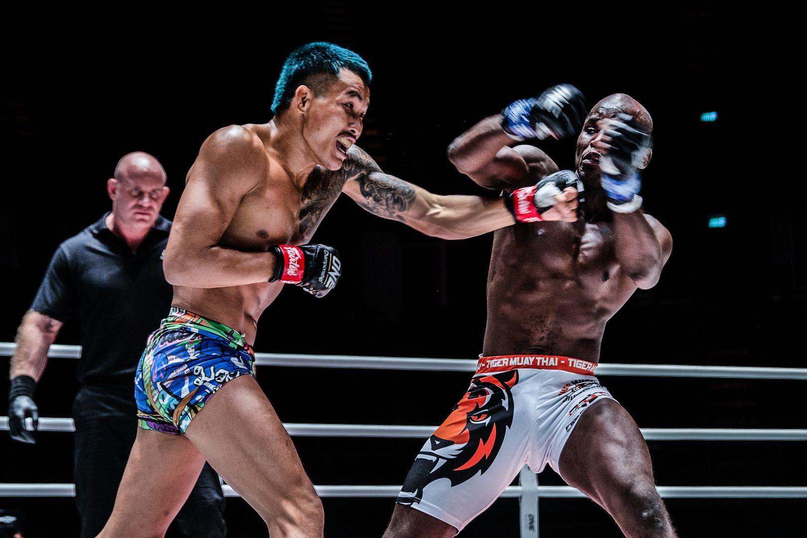 Mixed martial artist Yodkaikaew Fairtex cracks John Shink with an uppercut