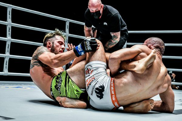 Russia's Abu Muslim Alikhanov goes for a leg lock
