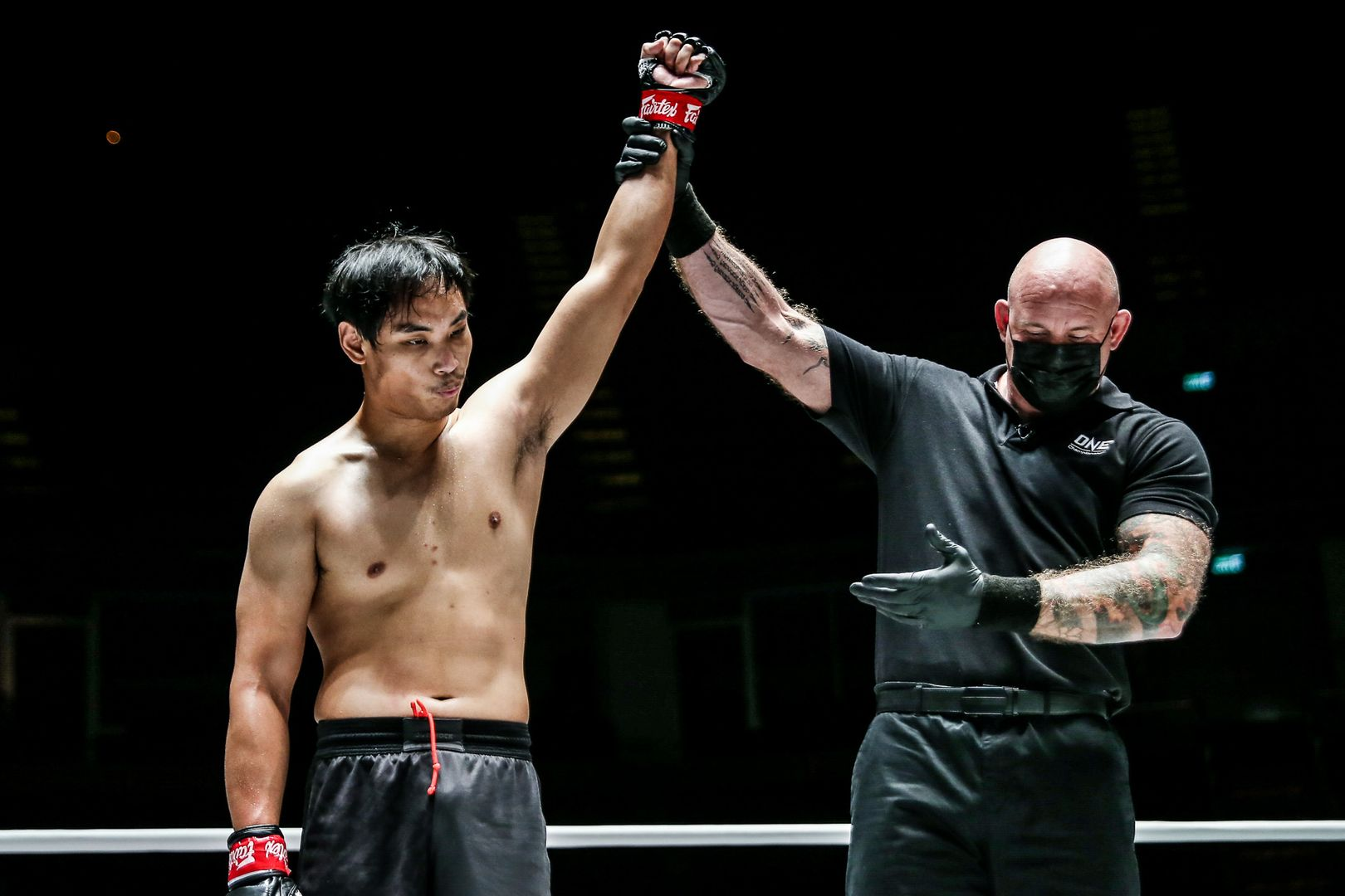 Witchayakorn Niamthanom with his arm raised following his debut victory