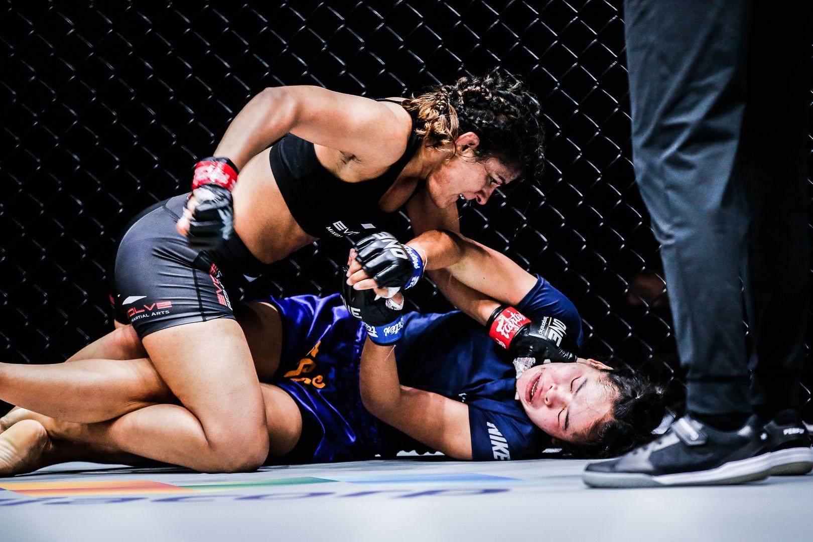 Indian wrestling icon Ritu Phogat unloads ground and pound on Nou Srey Pov