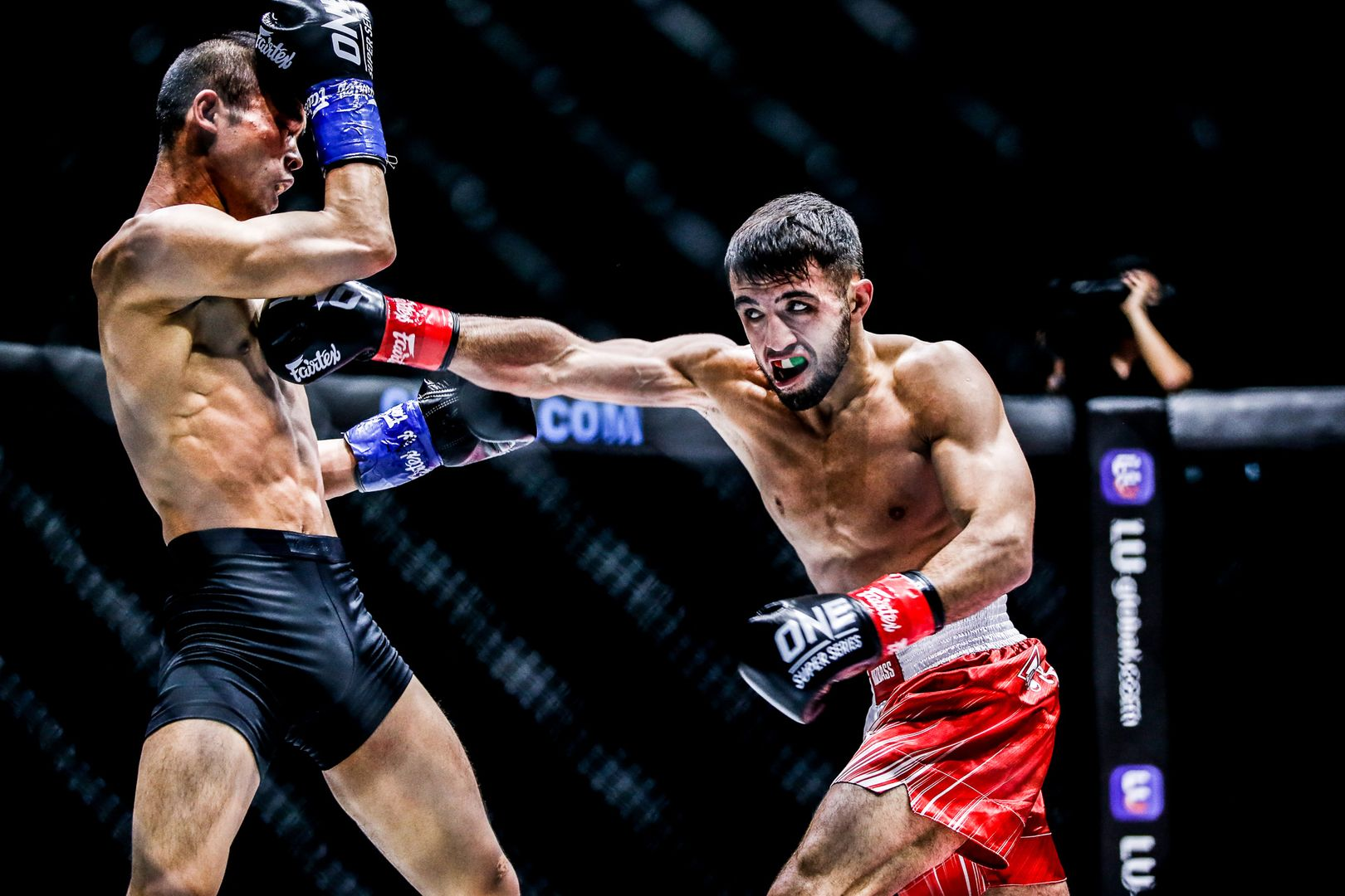 Russian fighter Aslanbek Zikreev fights former ONE World Title challenger Wang Junguang in a kickboxing match at ONE: INSIDE THE MATRIX IV