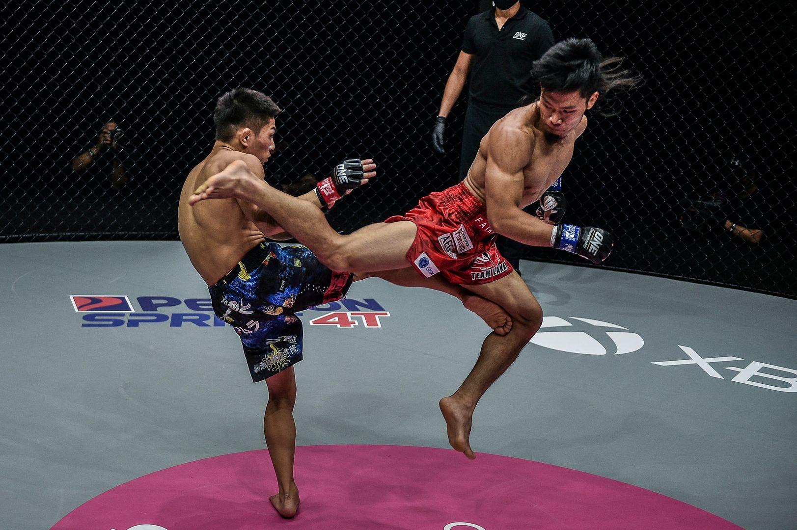 Filipino MMA fighter Lito Adiwang throws a spinning back kick at Hiroba Minowa