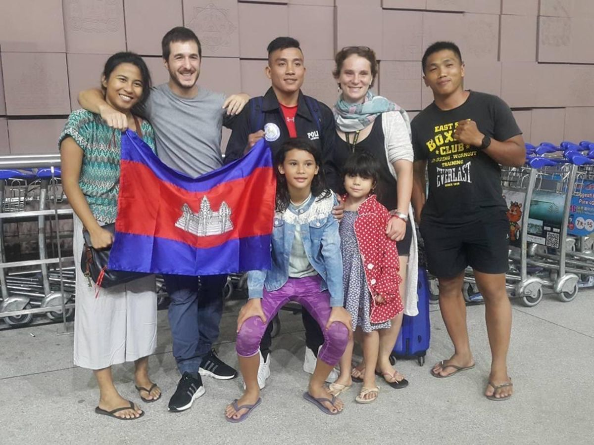 Cambodian MMA star Chan Rothana with his wife, two daughters, and friends