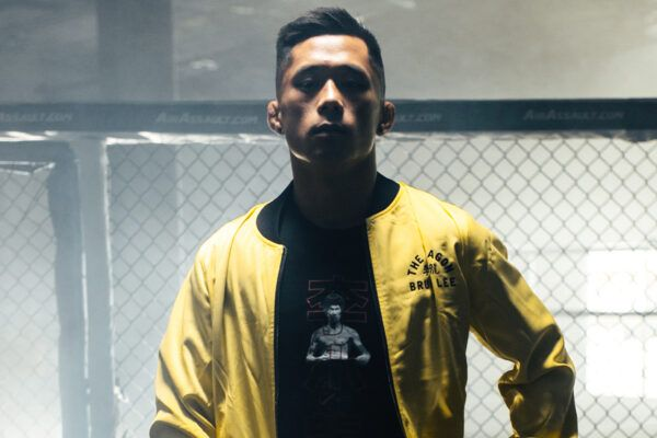 Martin Nguyen poses in the ONE x Bruce Lee Bomber Jacket