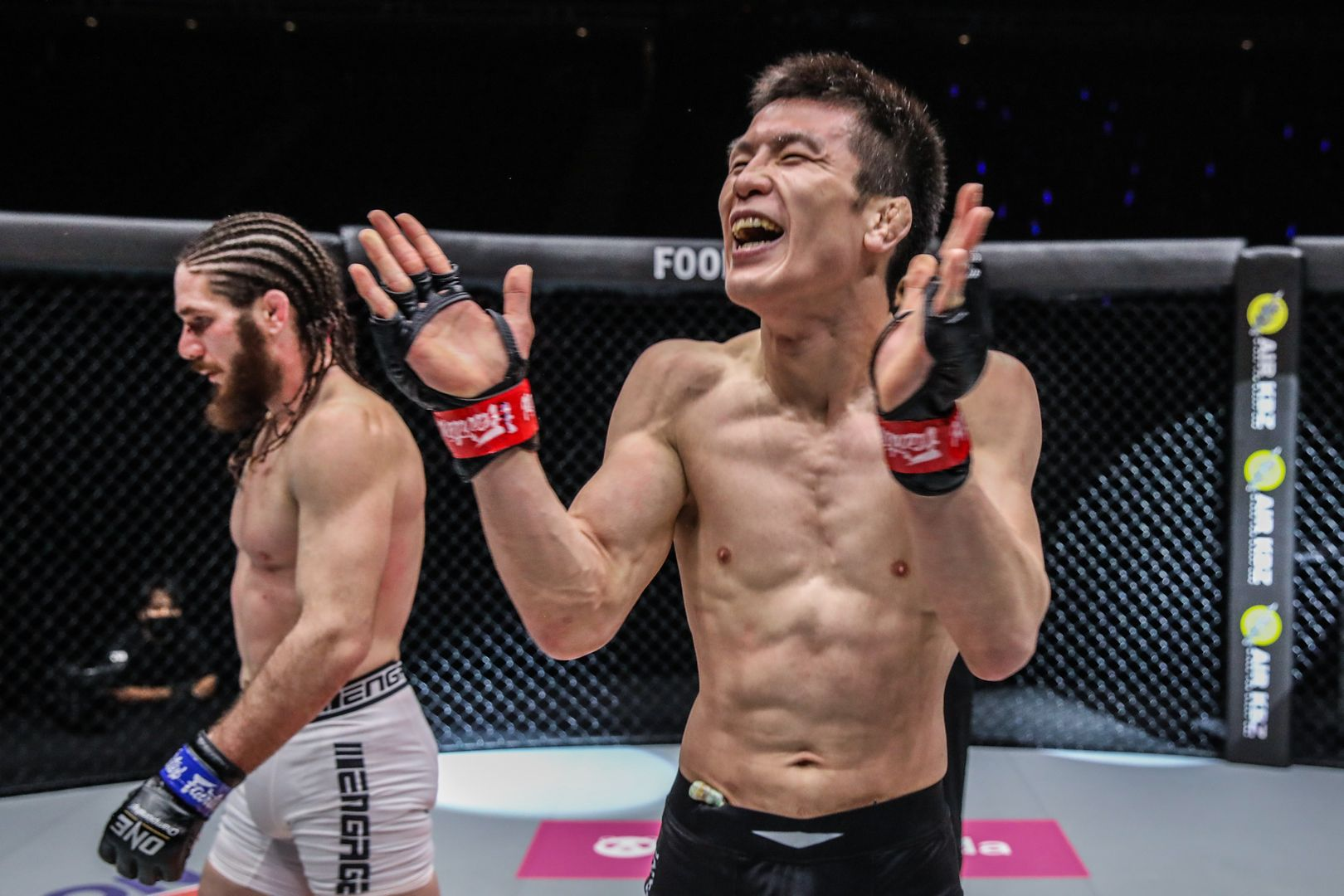 Japanese MMA fighter Shinya Aoki claps following his victory