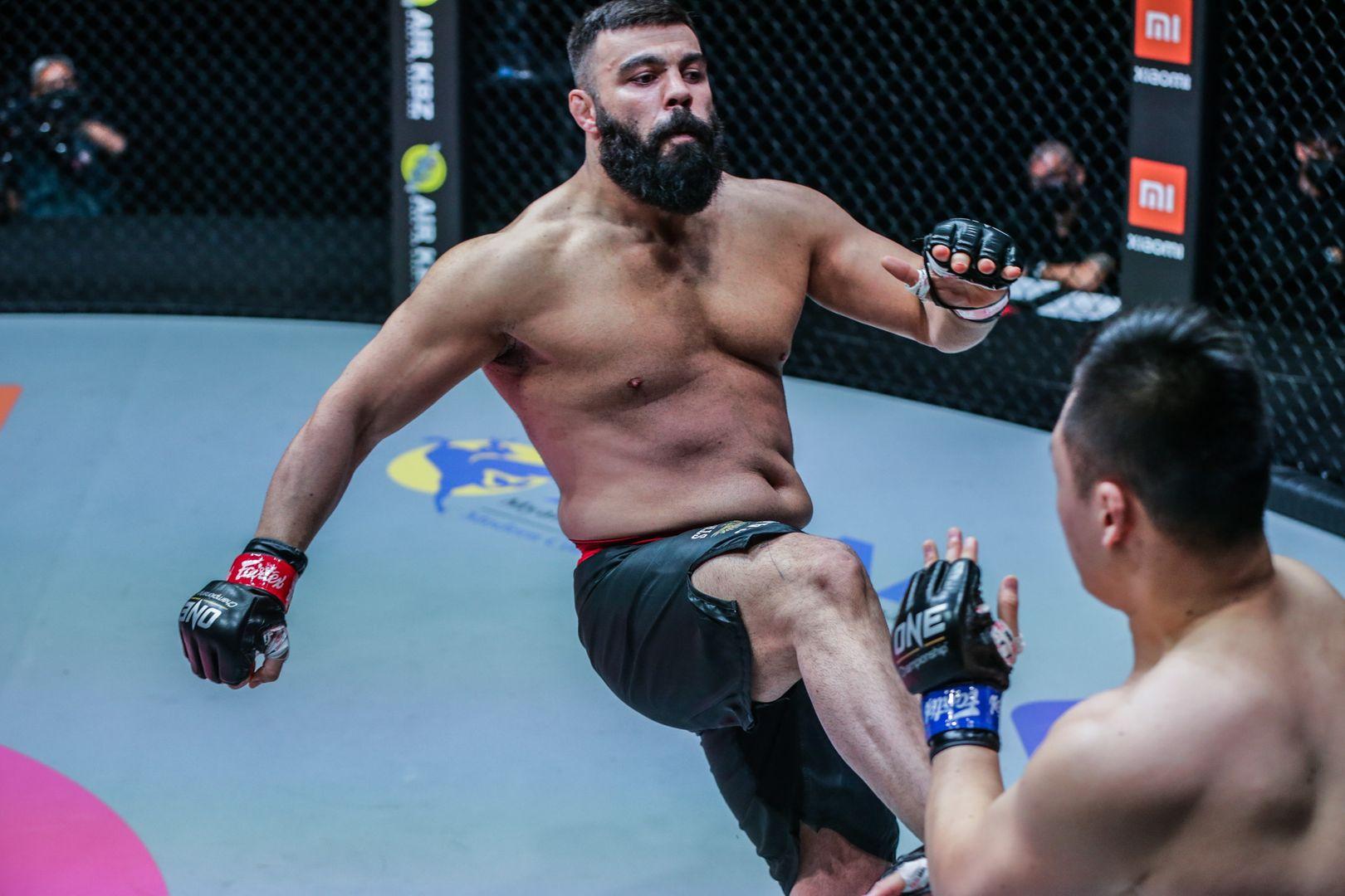 Amir Aliakbari throws a kick at Anatoly Malykhin at ONE: FISTS OF FURY II