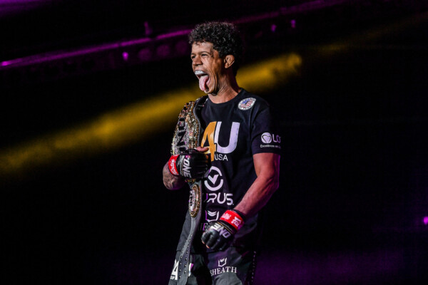 ONE Flyweight World Champion Adriano Moraes with the belt