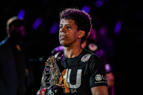 Brazilian MMA fighter Adriano Moraes enters the arena with the ONE Championship belt