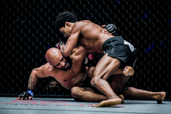 Brazilian MMA fighter Adriano Moraes drills Demetrious Johnson with a knee