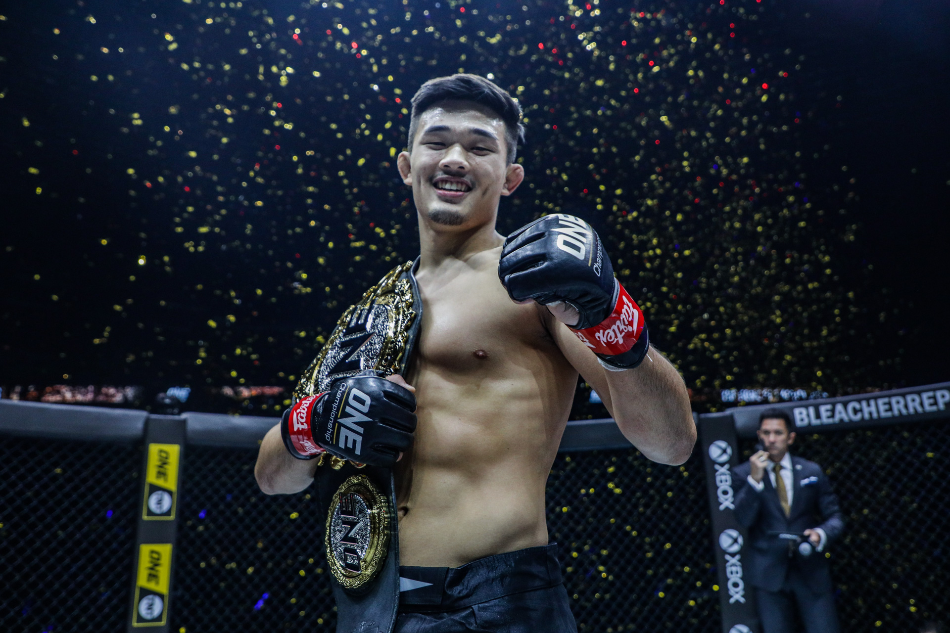 MMA fighter Christian Lee with the ONE Championship belt