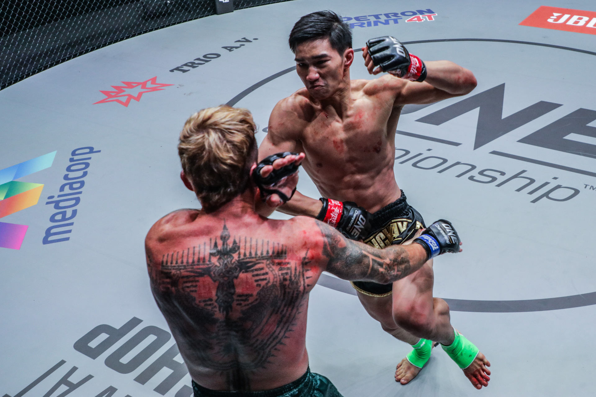 Pictures from the Muay Thai bout between Tawanchai PK.Saenchai Muaythaigym and Sean Clancy at ONE: DANGAL on 15 May