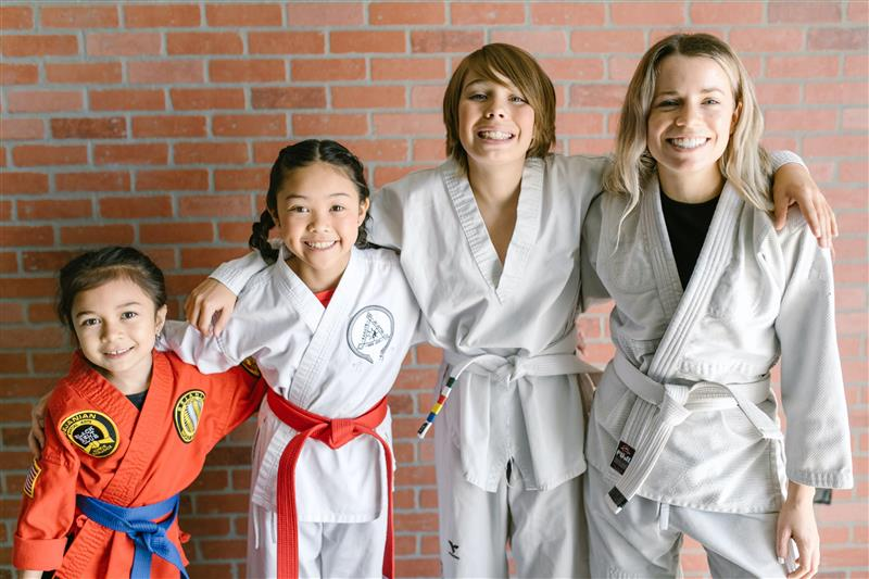 A group of kids get ready for martial arts class