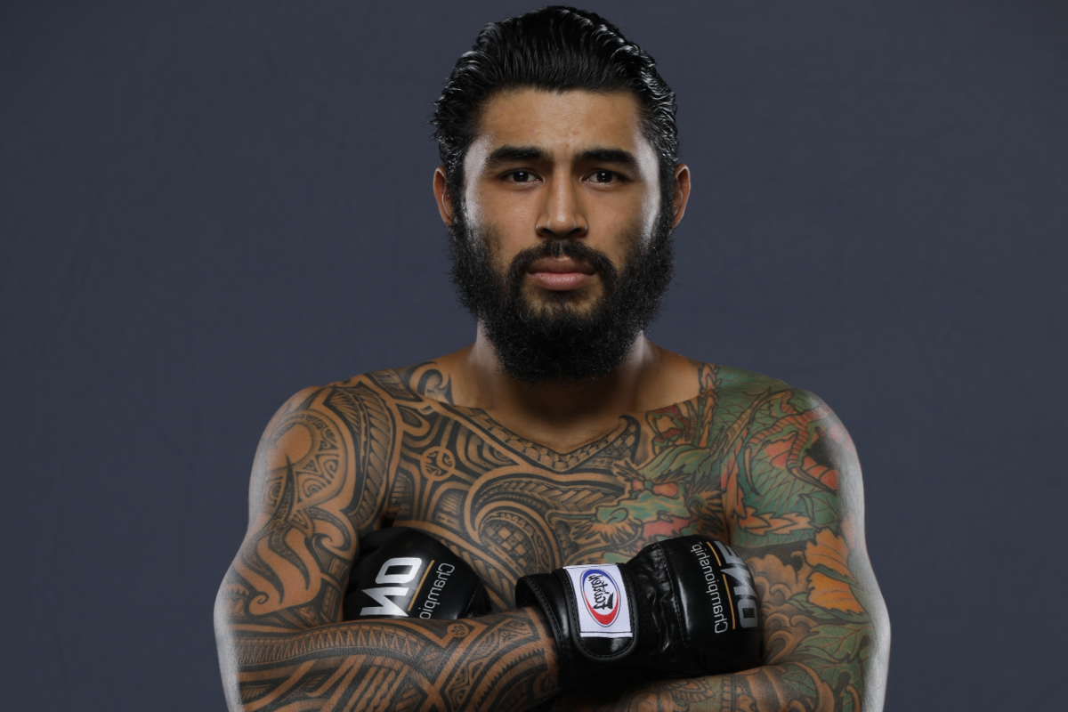 Lightweight MMA fighter Ben Wilhelm stands with his arms crossed