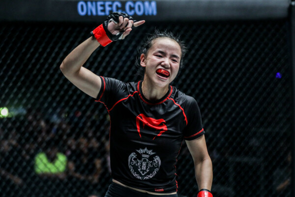 Chinese MMA fighter Lin Heqin celebrates a win