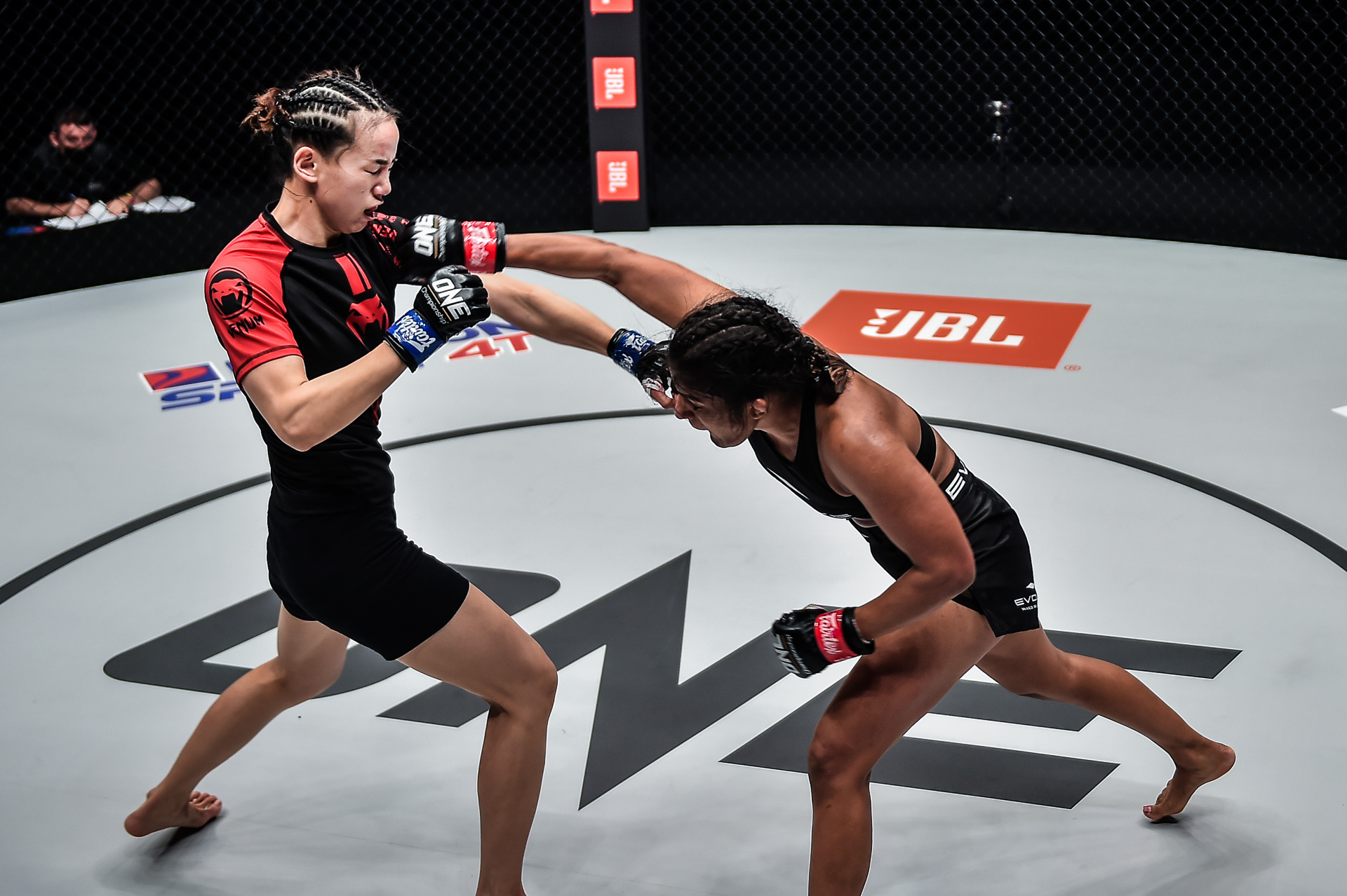 Pictures from the bout between Ritu Phogat and Lin Heqin at ONE: BATTLEGROUND