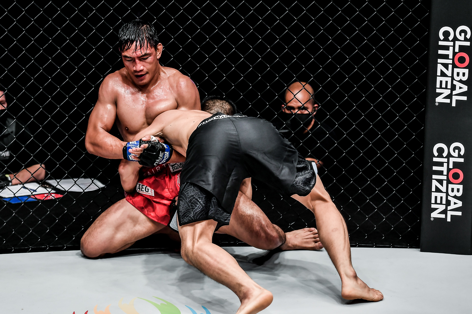 Pictures from the lightweight showdown between Eduard Folayang and Zhang Lipeng at ONE: BATTLEGROUND II