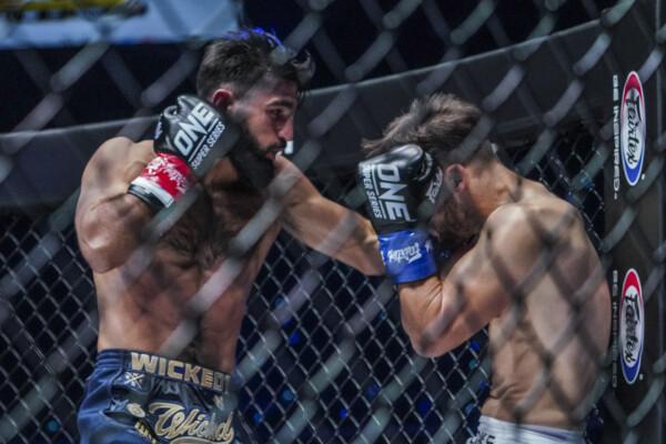 Marat Grigorian punches Andy Souwer