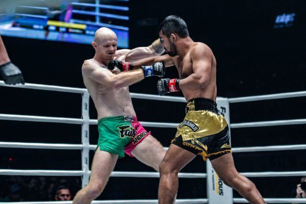 Rodlek PK.Saenchaimuaythaigym lands a right hand on Andrew Miller at ONE: DAWN OF HEROES.