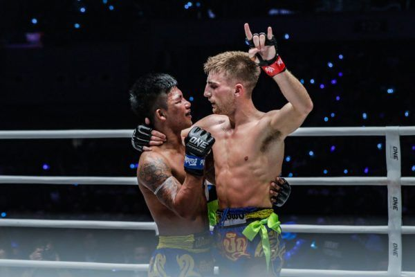 Jonathan Haggerty and Rodtang Jitmuangnon embrace after their ONE Flyweight Muay Thai World Title bout in Manila.