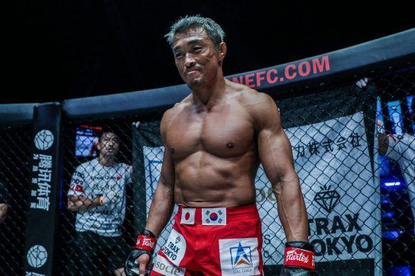 Japanese-Korean mixed martial arts legend Yoshihiro Akiyama smiles