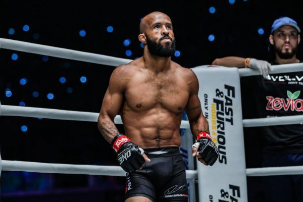 American martial arts star Demetrious Johnson stands in the corner