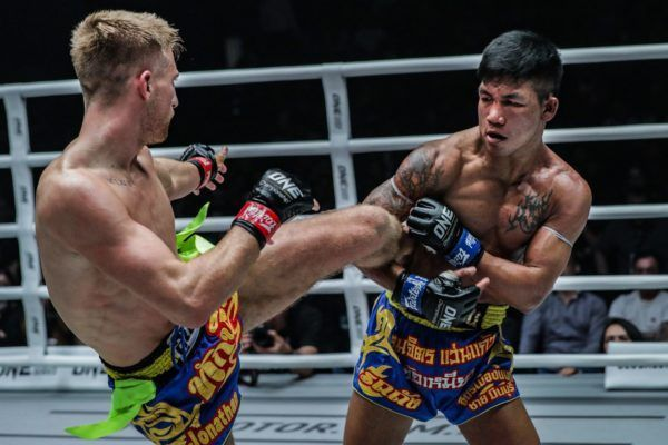 Rodtang Jitmuangnon catches Jonathan Haggerty's kick at ONE: DAWN OF HEROES.