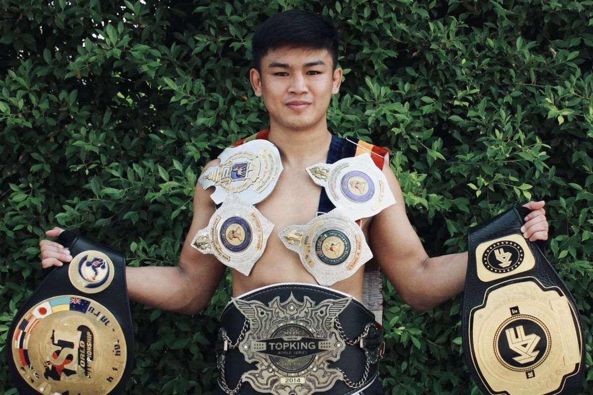 Sangmanee Sathian MuayThai poses with his World Title belts