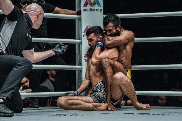 Rahul Raju locks in the rear-naked choke