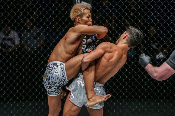 Japan's Taiki Naito goes for an elbow, but Rui Botelho goes for the sweep