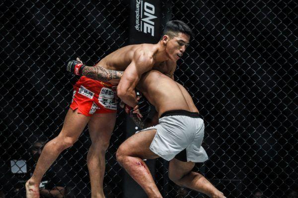 South Korean Yoon Chang Min grabs a headlock