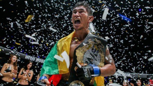 Aung La N Sang celebrates a triumphant victory.