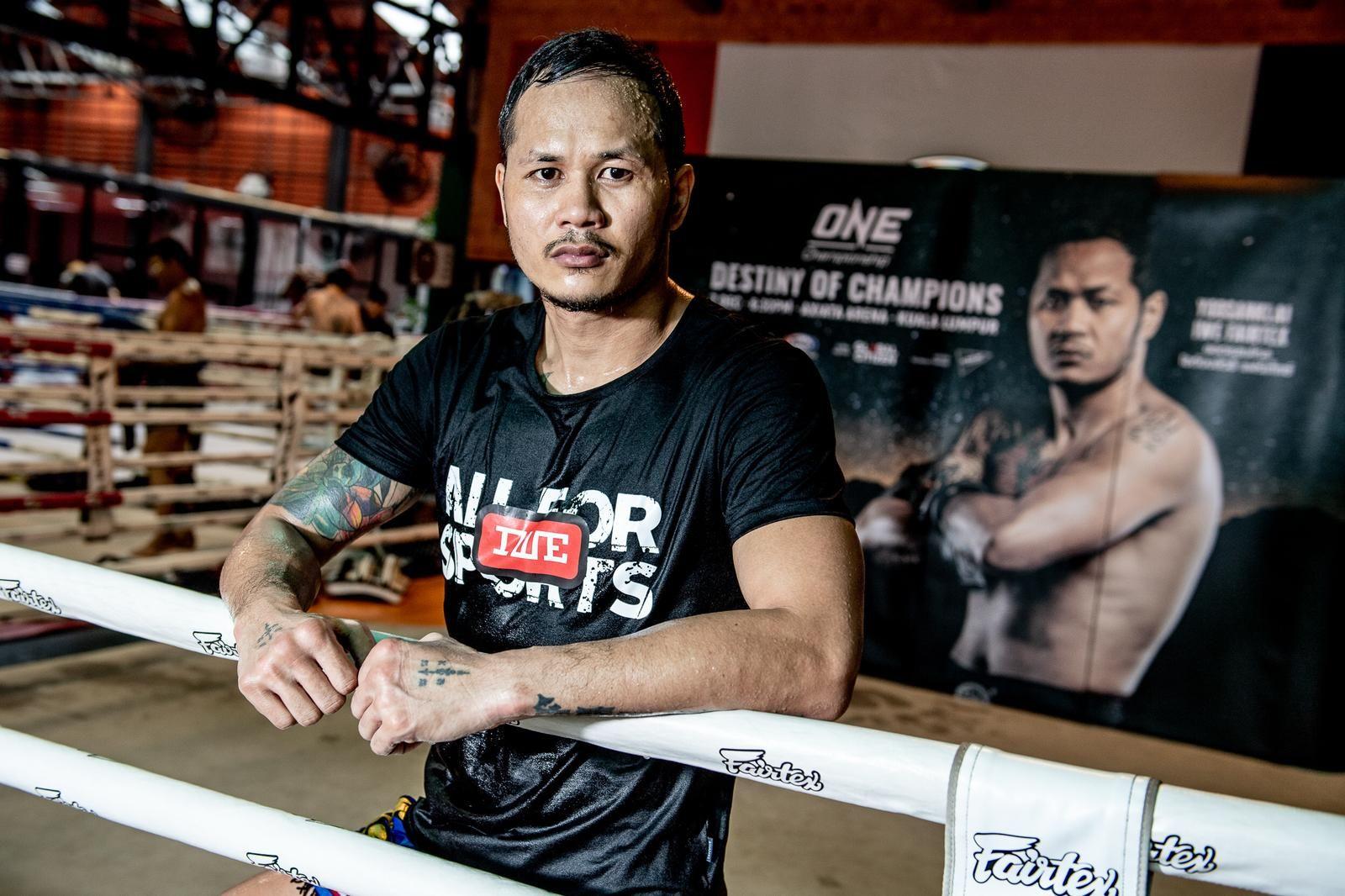 Muay Thai legend Yodsanklai IWE Fairtex stands in the ring