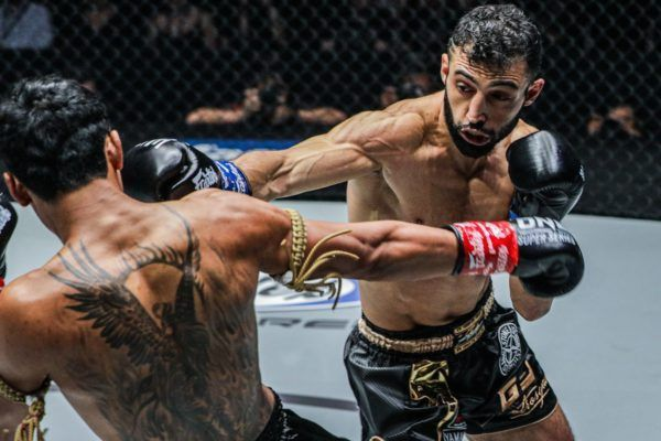 Italy's Giorgio Petrosyan connects with a jab on Jo Nattawut in Bangkok