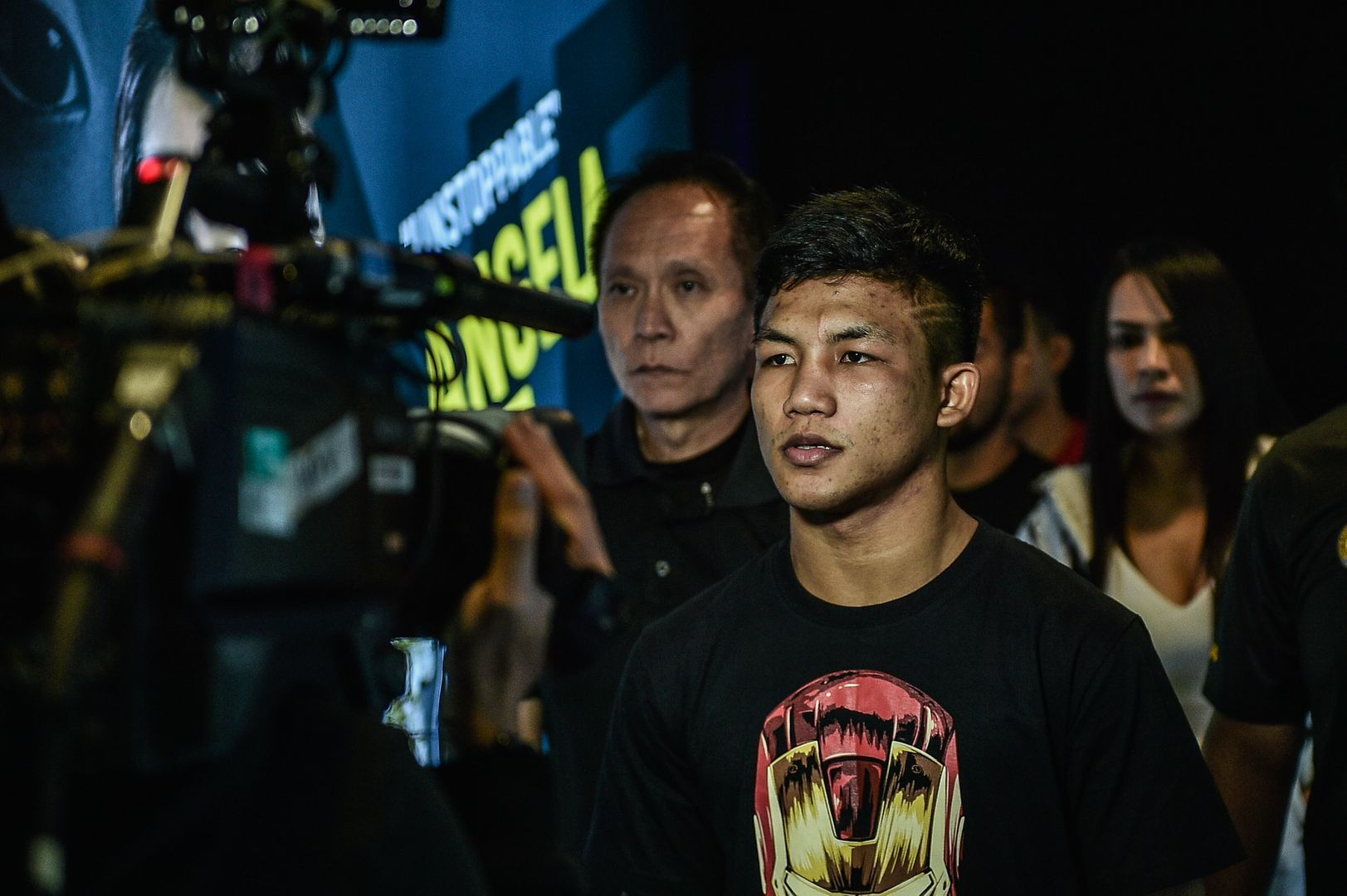 "Rodtang Jitmuangnon showcases his ""Iron Man"" shirt on his ring walk in Manila."