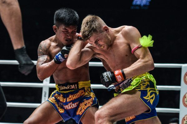 Rodtang Jitmuangnon strikes as Jonathan Haggerty blocks at ONE: DAWN OF HEROES.