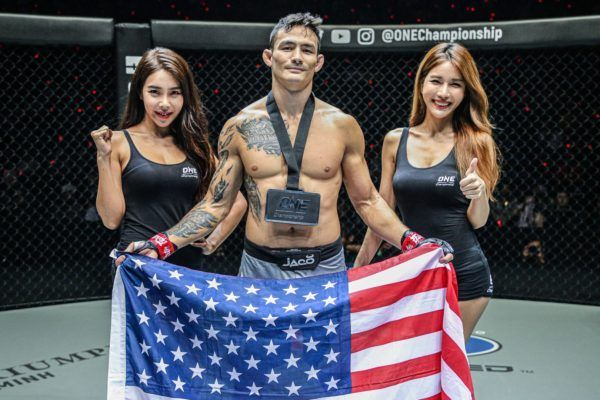 Vietnamese-American Thanh Le raises the stars and stripes following his knockout of Kotetsu Boku