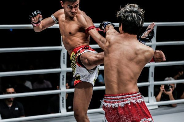 Panpayak Jitmuangnon scores with a kick against Masahide Kudo at ONE: IMMORTAL TRIUMPH