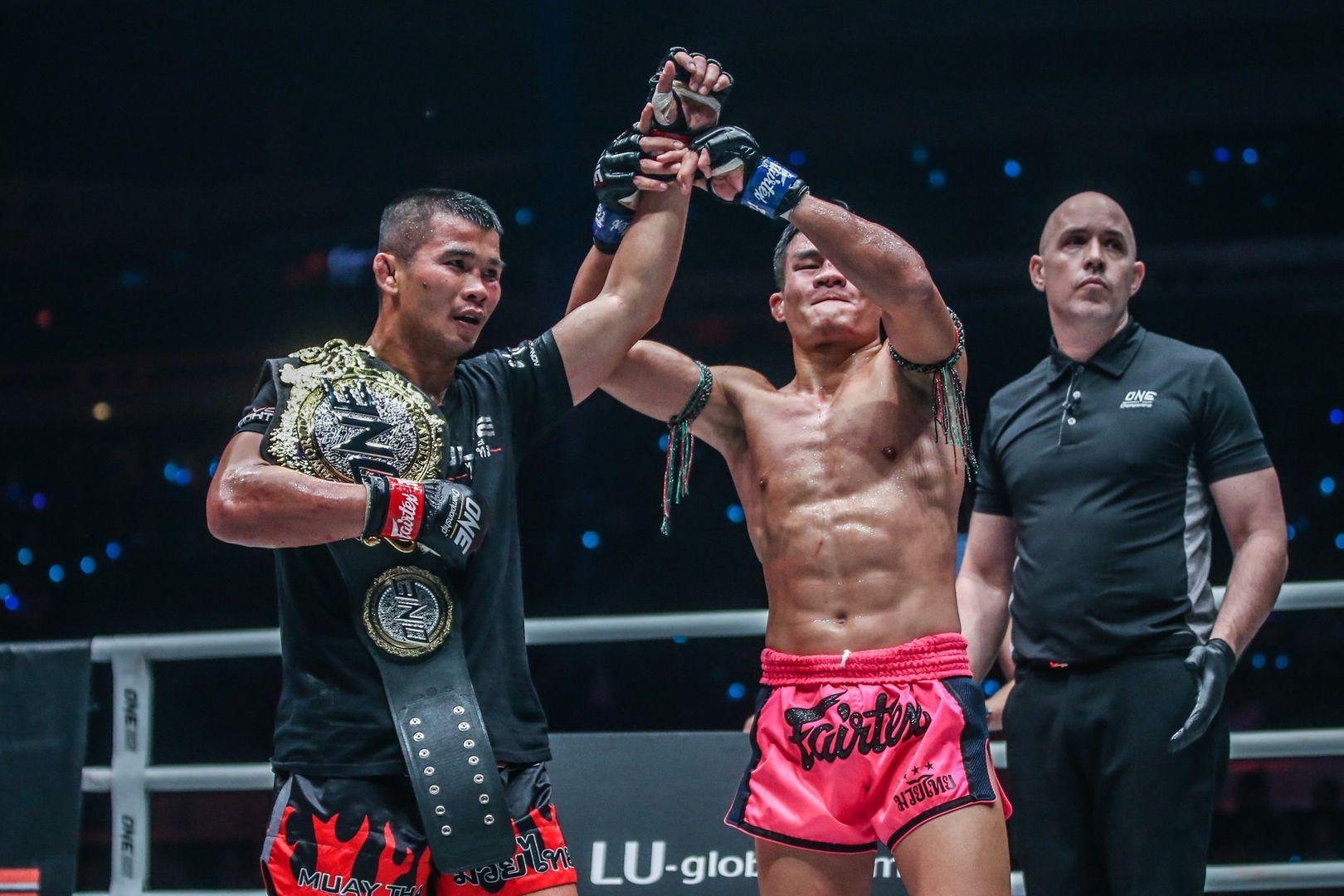 Nong-O Gaiyanghadao and Saemapetch Fairtex embrace following their Muay Thai fight