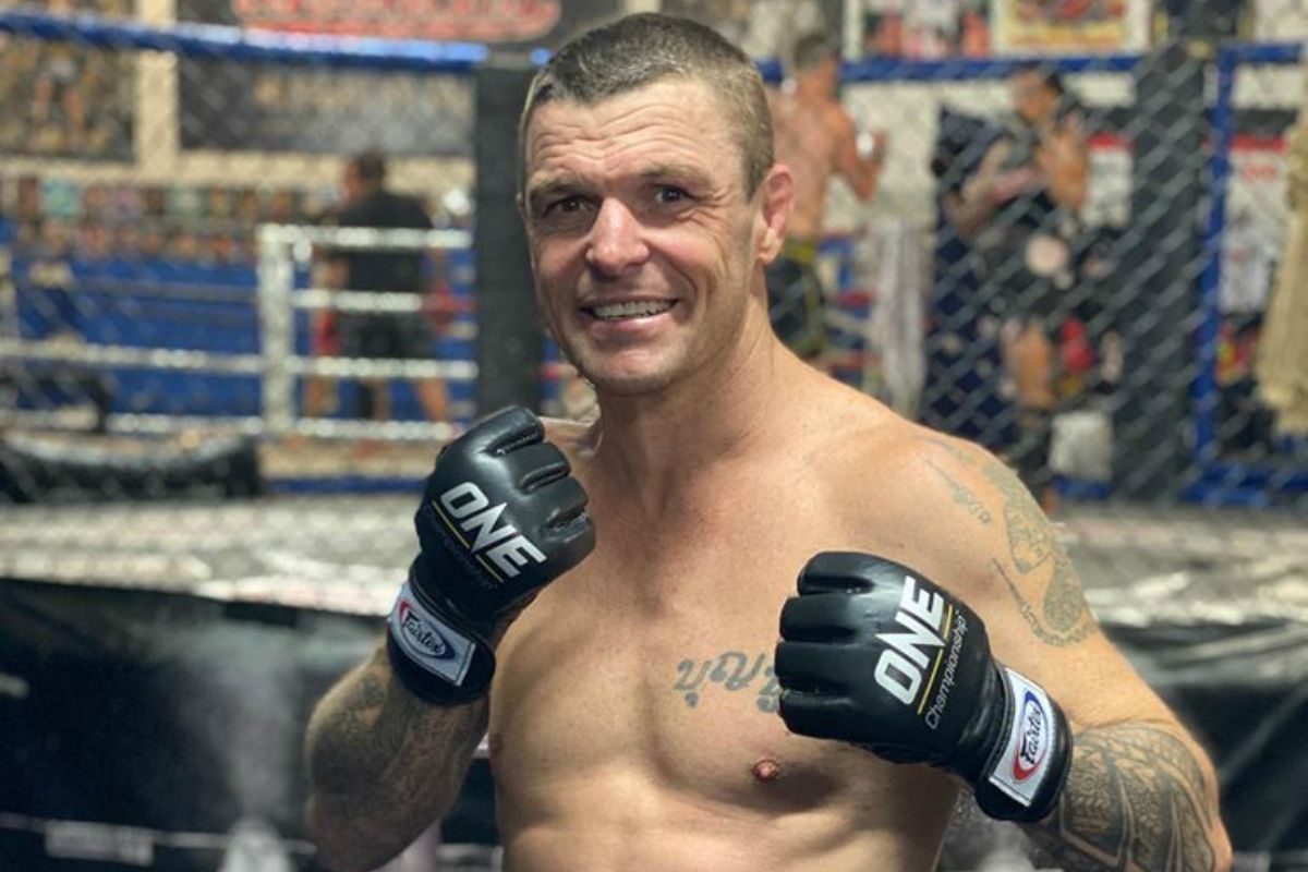 10-time Kickboxing and Muay Thai World Champion John Wayne Parr poses in his ONE Championship gloves