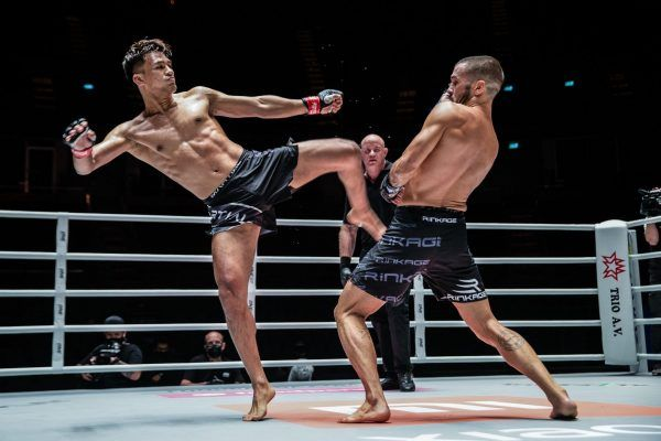 Thai mixed martial artist Shannon Wiratchai goes for a kick on Fabio Pinca