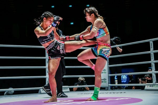 Brazilian Muay Thai fighter Allycia Hellen Rodrigues lands a roundhouse on Stamp Fairtex