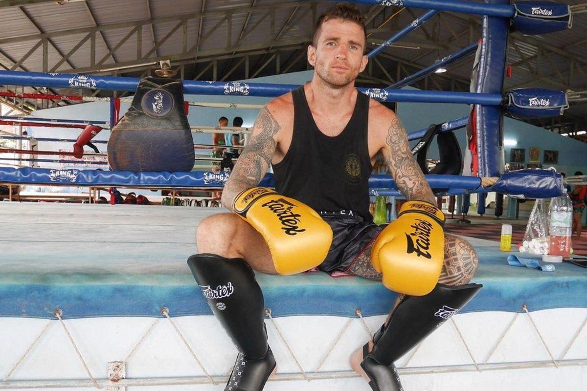 Irish Muay Thai World Champion Sean Clancy sits on the edge of the ring